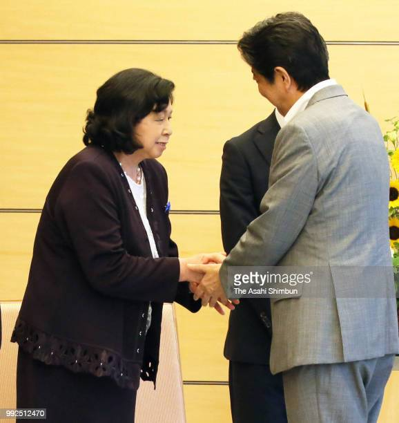 Former abductee by North Korea Hitomi Soga shakes hands with Prime Minister Shinzo Abe prior to their meeting at the prime minister's official...