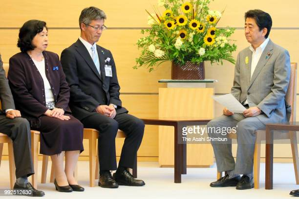 Former abductee by North Korea Hitomi Soga talks with Prime Minister Shinzo Abe during their meeting at the prime minister's official residence on...