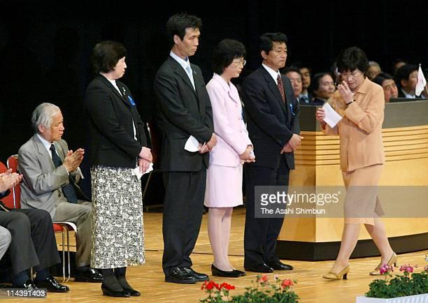 Former abductees by North Korea Hitomi Soga Kaoru Hasuike Fukie Chimura Yasushi Chimura and Yukiko Hasuike attend the national meeting to demand the...