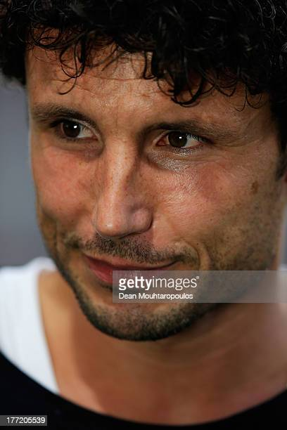 Former AC Milan and PSV footballer player Mark van Bommel speaks to the media prior to the UEFA Champions League Playoff First Leg match between PSV...
