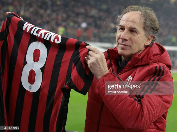 Former AC Milan player Franco Baresi holds up a shirt with Wilkins 8 written on the back in memory of his former teammate Ray Wilkins who died today...