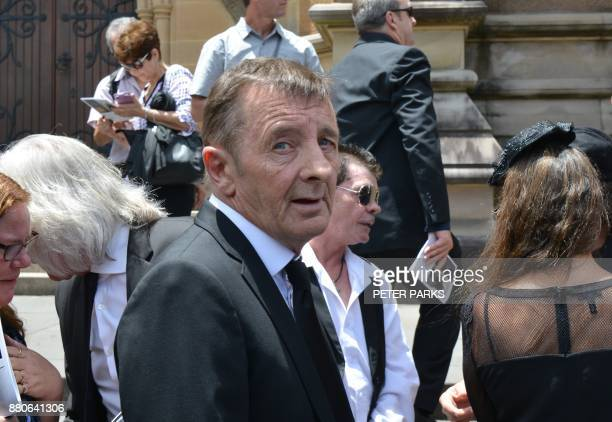Former AC/DC drummer Phil Rudd leaves St Mary's Cathedral after the funeral service of AC/DC cofounder Malcolm Young in Sydney on November 28 2017...