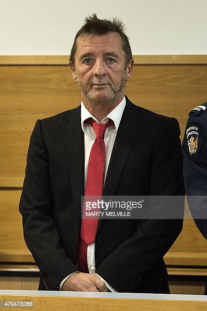 Former AC/DC drummer Phil Rudd stands in the dock facing charges at the District Court in Tauranga New Zealand on April 21 2015 The veteran rocker...