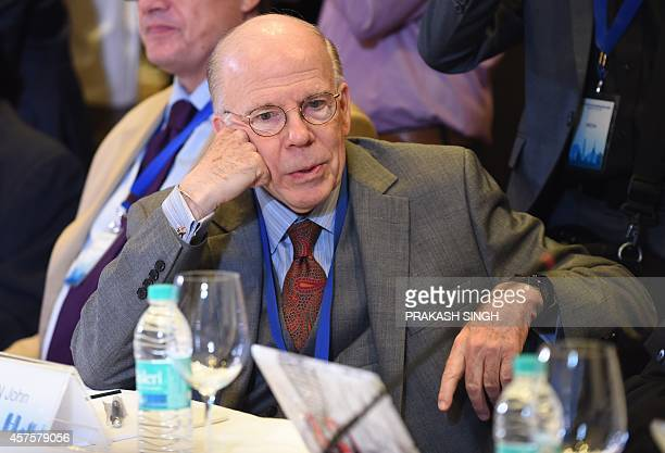 Former acting director of the US Central Intelligence Agency John McLaughlin listens to a speaker during the Munich Security conference in New Delhi...