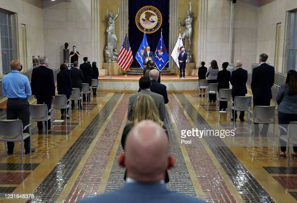 Former Acting U.S. Attorney General Monty Wilkinson introduces newly confirmed U.S. Attorney General Merrick Garland before he addresses staff on his...