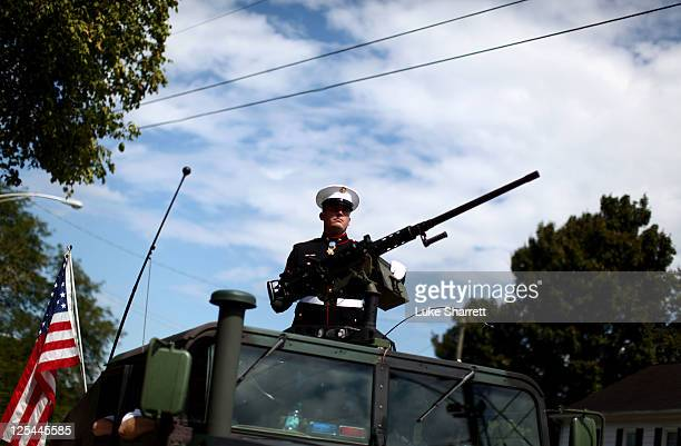 Former active duty Marine Corps Corporal and Medal of Honor recipient Dakota Meyer stands atop a military humvee while leading the Cow Days Festival...