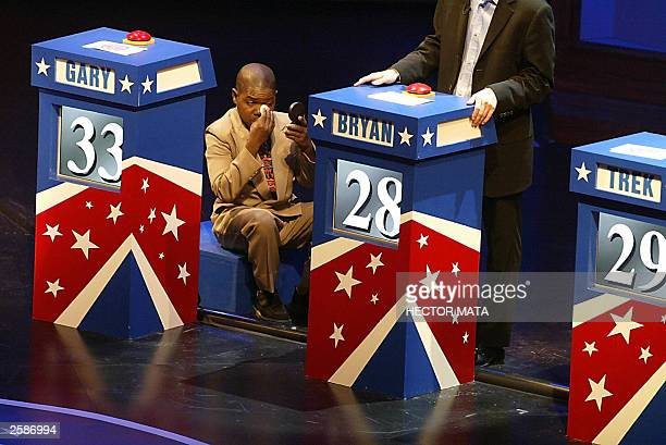Former actor and gubernatorial candidate Gary Coleman applies makeup during a break of the taping Who Wants to be Governor of California Debatin Game...
