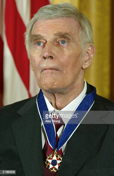 Former actor Charlton Heston wears the Presidential Medal of Freedom after being honored by US President George W Bush during an East Room event at...
