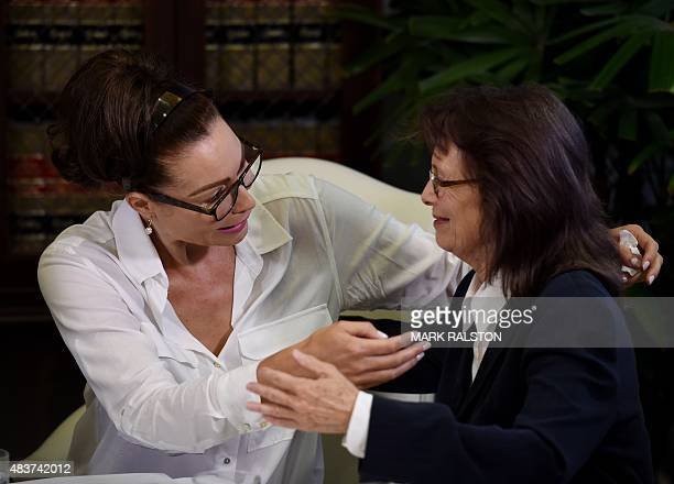 Former actress Eden Tirl who is one of three new alleged sexual assault victims of comedian Bill Cosby consoles Linda Ridgeway Whitedeer during a...