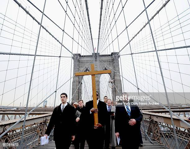 Former addick Frankie Simmonds carried cross as he leads procession across Brooklyn Bridge during Way of the Cross ceremony