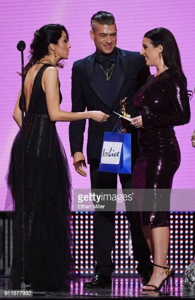 Former adult film actress/director Jenna Haze and adult film actor Xander Corvus present adult film actress/director and cohost Angela White with the...