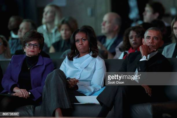 Former advisor to the president Valerie Jarrett and former first Lady Michelle and president Barack Obama listen to speakers at the inaugural Obama...