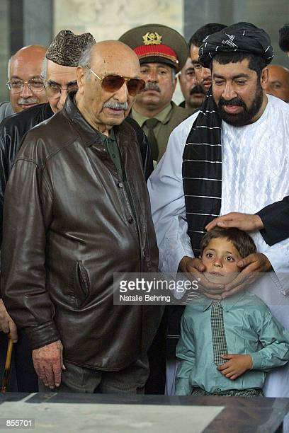 Former Afghan King Zahir Shah Kandahar governor Gul Agha and his son Ahmed visit the tomb of Shah's father Nadir Shah April 19 2002 in Kabul Shah...