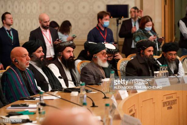 Former Afghan president Hamid Karzai and Taliban co-founder Mullah Abdul Ghani Baradar attend an international conference on Afghanistan over the...