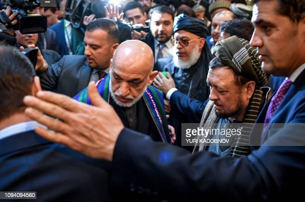 Former Afghan president Hamid Karzai arrives for the opening of the twoday talks of the Taliban and Afghan opposition representatives at the...