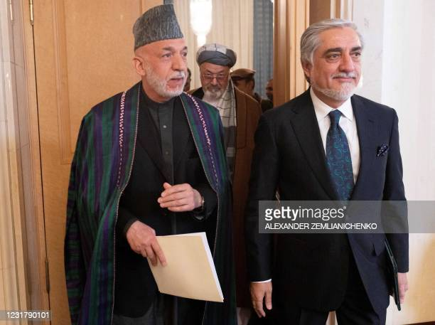Former Afghan president Hamid Karzai attends an international conference on Afghanistan over the peaceful solution to the conflict in Moscow on March...