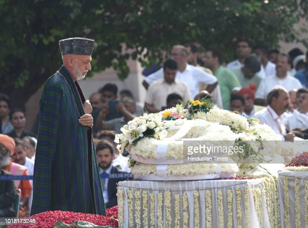 Former Afghanistan president Hamid Karzai pays his final respects during the cremation ceremony of former Prime Minister Late Atal Bihari Vajpayee at...