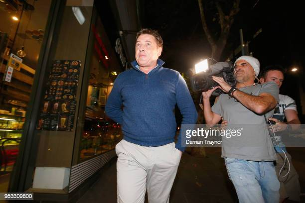 Former AFL coach and VFL player Mark 'Bomber' Thompson leaves Melbourne Magistrates Court after being charged with several drug offences on May 1...