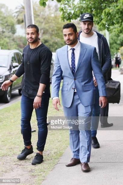 Former AFL Diversity Manager Ali Fahour leaves Heidelberg Magistrates Court with supporter and former Saints footballer Ahmed Saad on October 11 2017...