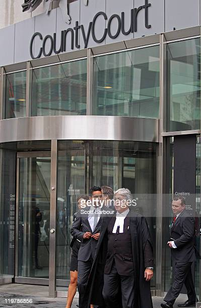 Former AFL player Andrew Lovett departs the Victorian County Court after being found not guilty on two counts of rape on July 25 2011 in Melbourne...