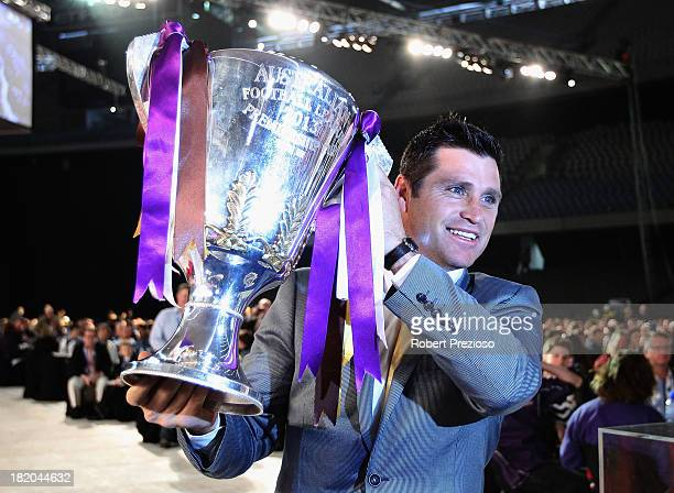 Former AFL player Shane Crawford holds the 2013 Premiership Cup during the 2013 Blackwoods North Melbourne Grand Final Breakfast at Etihad Stadium on...