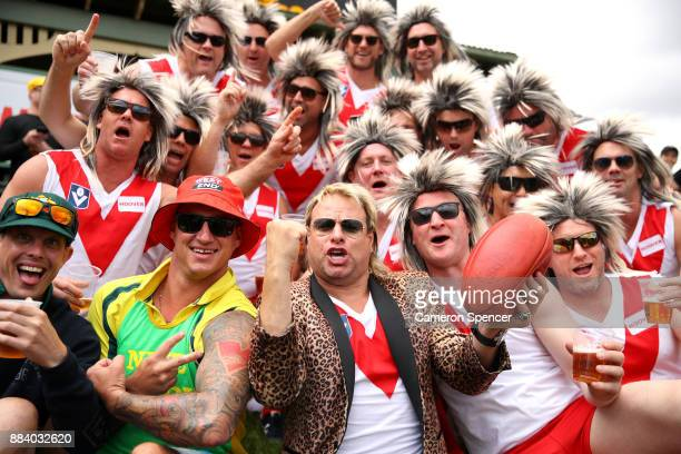 Former AFL player Warrick Capper poses with look alike fans during day one of the Second Test match during the 2017/18 Ashes Series between Australia...