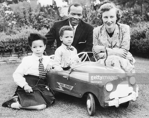 Former African Tribal chief Seretse Khama relaxes in the garden of his home here with his English wife Ruth and their two children Jacqueline and...
