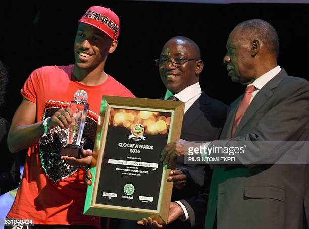 Former Africa's best player Gabonese PierreEmerick Aubameyang receives the second best player award from Nigeria's Sports Minister Solomon Dalung and...