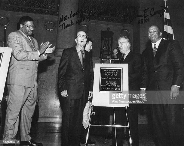 Former Afro American Newspapers sports reporter Sam Lacy and politician and Maryland congressional representative Elijah Cummings during a building...
