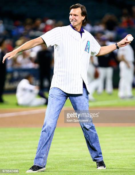 Former against the Arizona Diamondbacks pitcher Randy Johnson throws the first pitch during the MLB baseball game between the Arizona Diamondbacks...