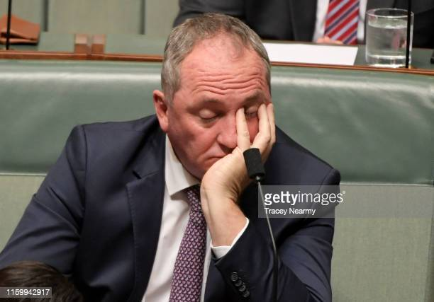 Former agriculture minister Barnaby Joyce reacts as the Prime Minister is asked about water resources and the drought during question time in the...