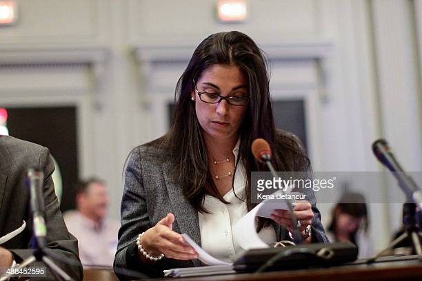 Former aide to New Jersey Gov Chris Christie Christina Renna looks at papers as she testifies during a hearing by the New Jersey Legislature's Select...