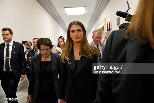 Former aide to President Trump, Hope Hicks takes a break from a hearing at the Rayburn House Building where so far she has refused to answer...