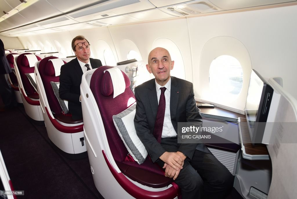 Former Airbus CEO Louis Gallois sits aboard an A350 during an hour flight over France on December 22, 2014. Airbus delivered its first next-generation A350-900 plane to Qatar Airways Monday in a formal ceremony that kickstarts its bid to erode rival Boeing's dominance in the lucrative long-haul market.