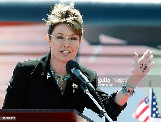 Former Alaska Gov Sarah Palin jokes about having writing on her hand as she speaks at the Tea Party Express' Showdown in Searchlight rally March 27...