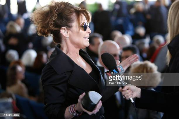 Former Alaska Governor Sarah Palin gives a media interview before the start of a funeral service for Rev Billy Graham at the Billy Graham Library on...