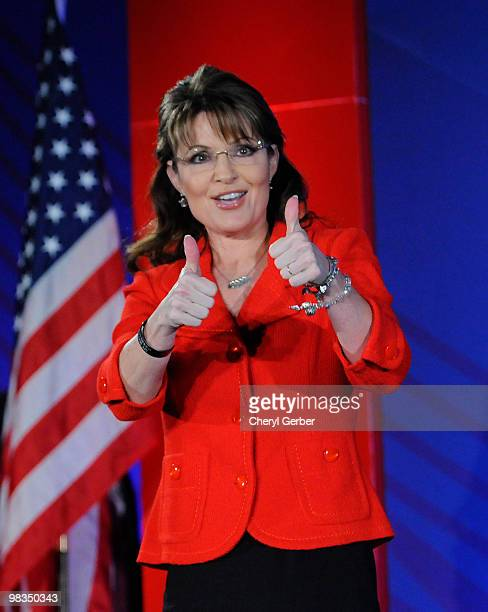 Former Alaska Governor Sarah Palin gives two thumbs up to the audience at the Southern Republican Leadership Conference April 9 2010 in New Orleans...