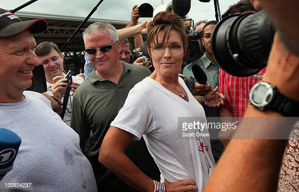 Former Alaska Governor Sarah Palin greets visitors at the Iowa State Fair August 12 2011 in Des Moines Iowa Palin joined most of the declared...