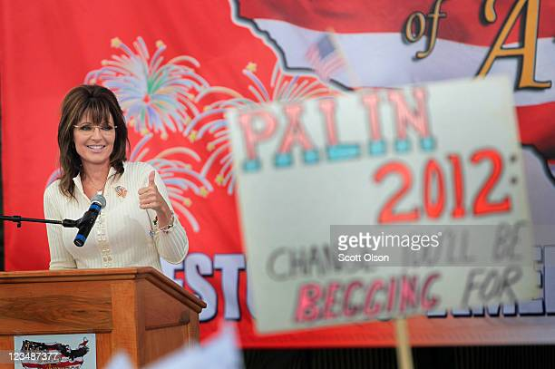 Former Alaska Governor Sarah Palin speaks to supporters during the Tea Party of America's Restoring America event at the Indianola Balloon Festival...
