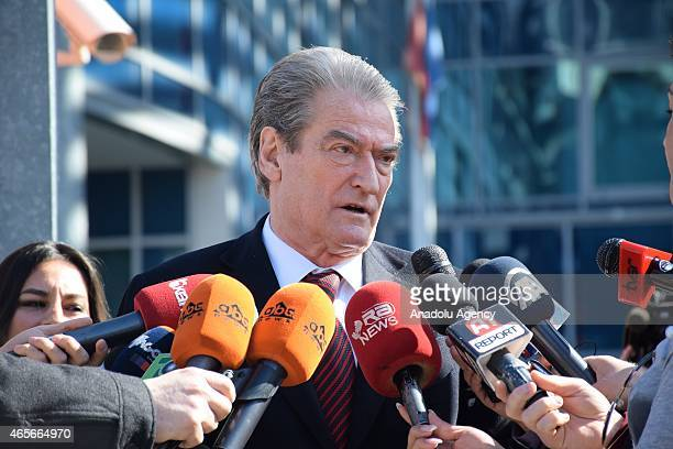Former Albanian Prime Minister Sali Berisha speaks to the media outside the prosecution office after he testified on an assassination attempt on...