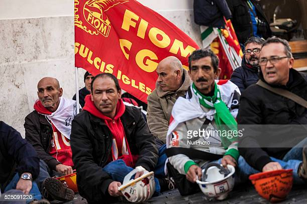Former Alcoa workers wave flags and shout slogans as they protest against plant closure in Rome Italy on 16 February 2016 Two hundreds former Alcoa...