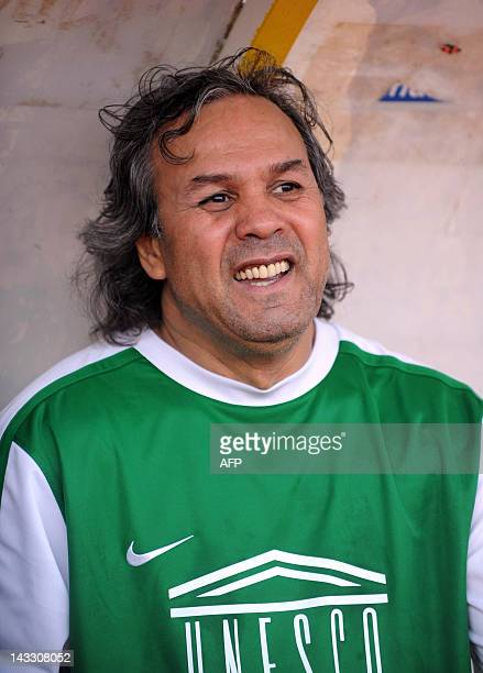 Former algerian football star and UNESCO Goodwill Ambassador Rabah Madjer reacts during a gala football match for African children at the July 5th...