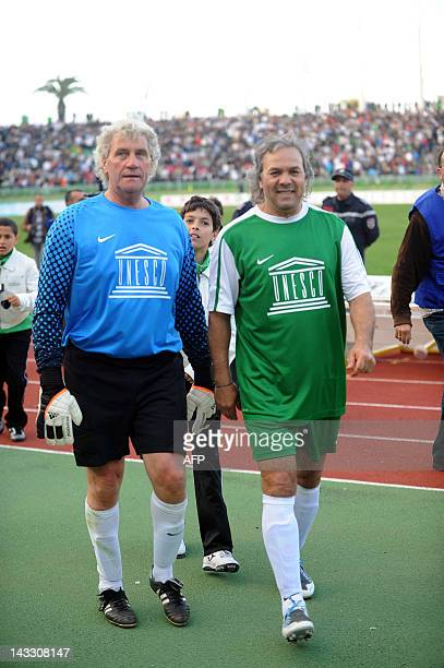Former Algerian football star and UNESCO Goodwill Ambassador Rabah Madjer and Former Belgian goalkeeper JeanMarie Pfaff take part in a gala football...