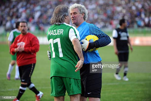 Former Algerian football star and UNESCO Goodwill Ambassador Rabah Madjer chats with Former Belgian goalkeeper JeanMarie Pfaff as they take part in a...