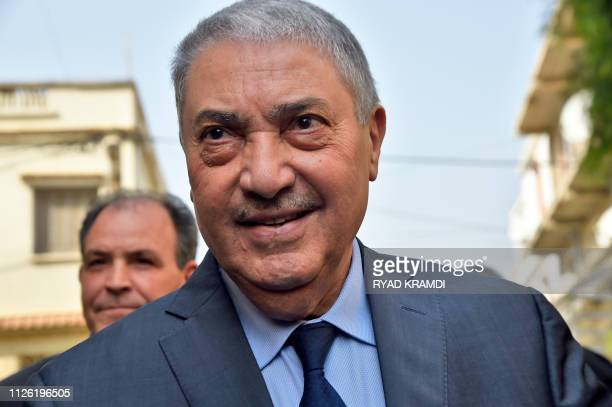 Former Algerian prime minister Ali Benflis, who heads the Avant Garde of Freedom party, arrives at a meeting of opposition figures in Algiers on...