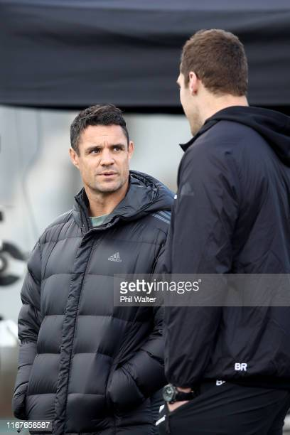 Former All Black Dan Carter chats with Brodie Retallick during a New Zealand All Blacks training session at Trusts Stadium on August 13 2019 in...