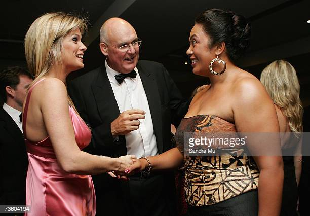 Former All Black now Rachel Hunter's agent Andy Haden introduces Rachel to New Zealand discus thrower Beatrice Faumuina at the predinner drinks...