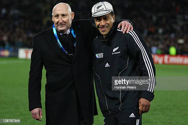 Former All Black's captain and NZRU Chairman Jock Hobbs presents Mils Muliaina of the All Blacks with his 100th test cap during quarter final four of...