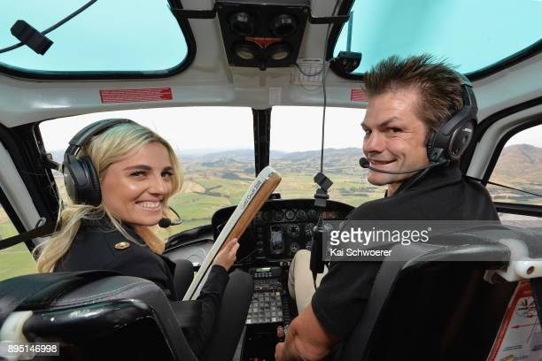Former All Blacks captain Richie McCaw and former New Zealand hockey player Gemma McCaw pose with the Commonwealth Games Queen's baton on their way...