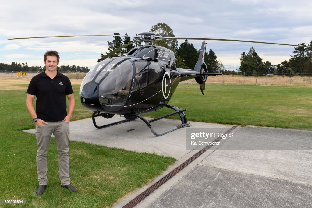 Former All Blacks captain Richie McCaw poses in front of a helicopter on his way to a Queens Baton Relay event on December 19, 2017 in Christchurch, New Zealand.